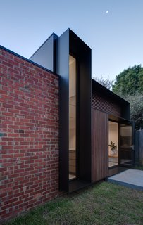 Recycled red bricks are used for sections of the exterior walls.