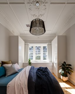 The stucco ceiling in the bedroom was restored.