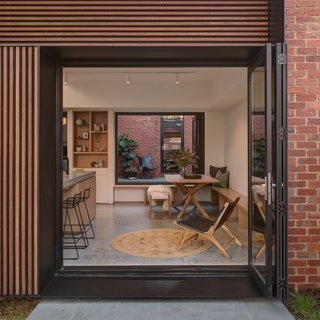 One side of the exterior is clad in spotted gum timber battens.
