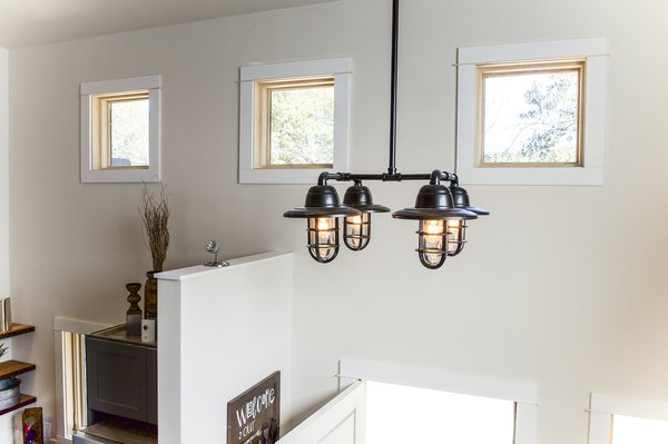 An Edison bulb chandelier made from steel pipe.