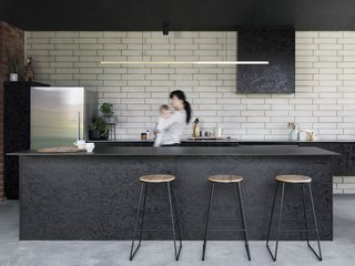 Fisher & Paykel appliances outfit the kitchen, where stainless steel countertops provide a sleek counterpoint to concrete bricks and flooring.