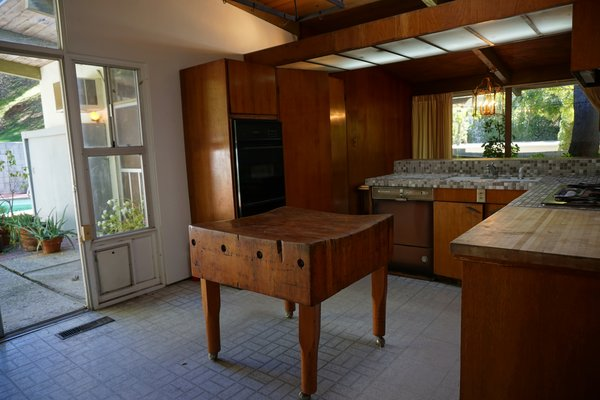 The original L-shaped kitchen was closed off and lacked storage, so Martin opened it up by taking out the doorway to the hall and extending the space to the ceiling.