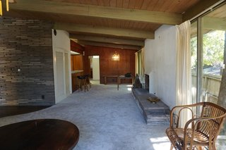 The house is located in the Santa Monica mountains. It was built in 1958, along with a carport and a boomerang-shaped pool.