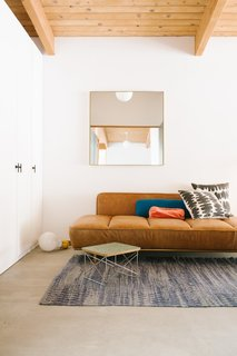 """A CB2 """"Lawndale"""" daybed, and carpet from Serena and Lily."""