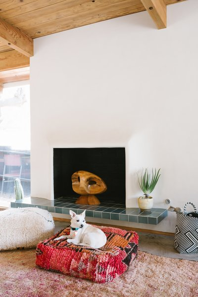 Martin and Katz plastered over the stucco finish of the fireplace wall with soft gray Venetian plaster.