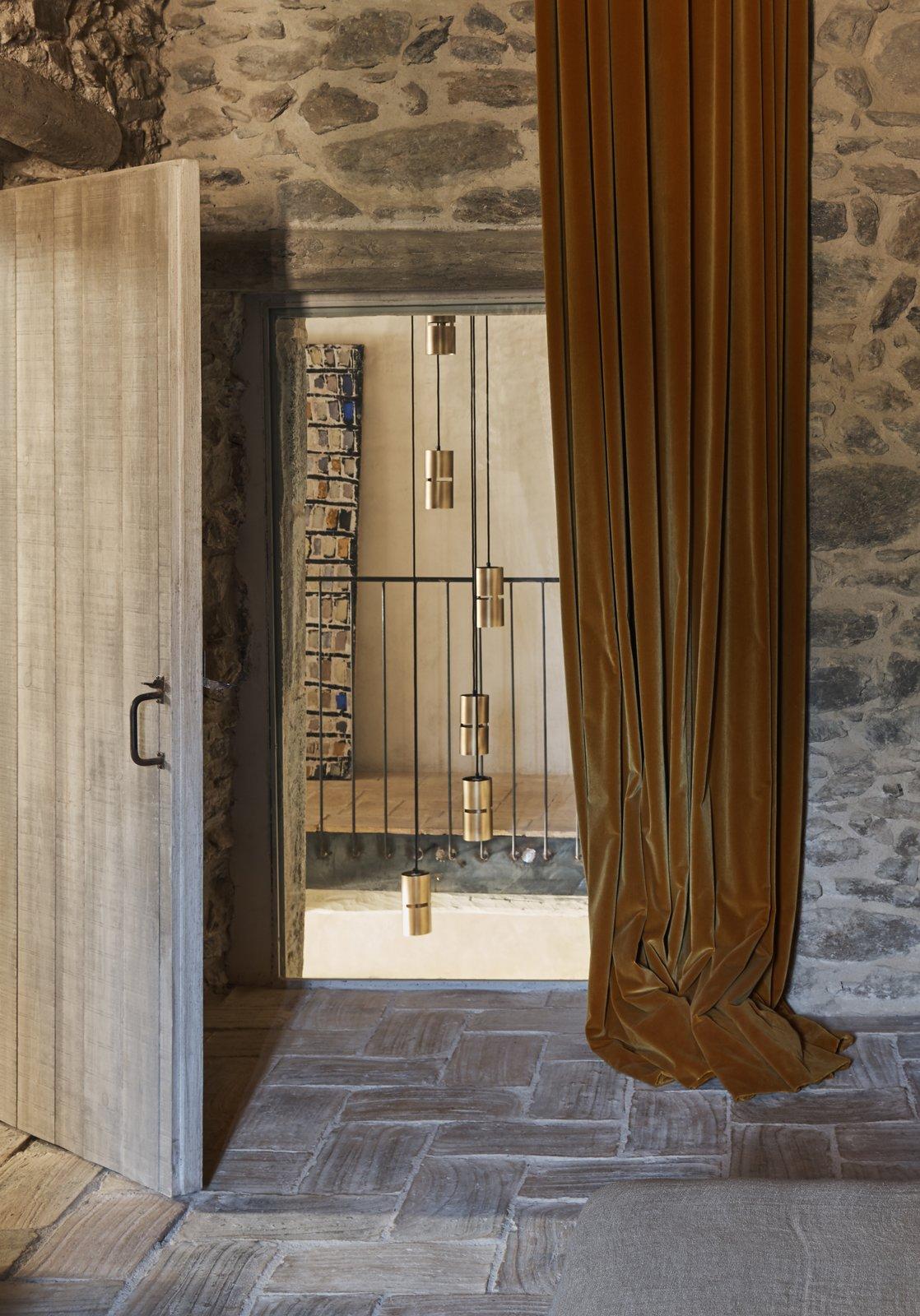 Catalan Farmhouse window with velvet curtains