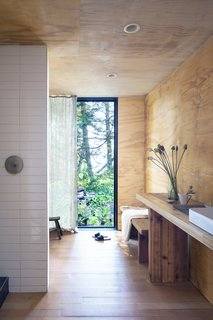 The countertops and interior cladding were created from reclaimed beams and siding from the original cabin.