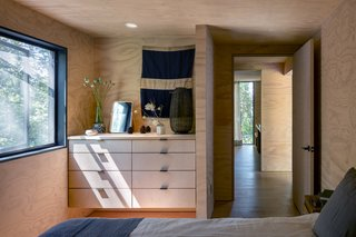 Within, plywood walls and ceilings combine with warm cedar boards and cast-in-place concrete to elevate the simple cabin concept.