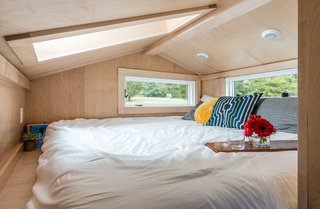 A king-sized bed fits snugly in the loft.