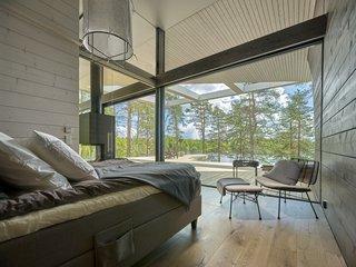 The master bedroom enjoys lake views.