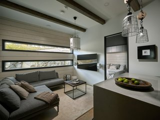 A lounge area leads to the master bedroom.