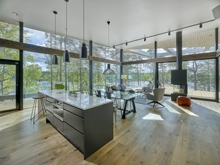 An open-plan kitchen, dining, and living space.