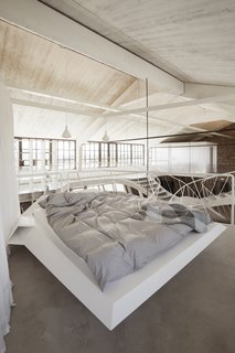 A custom-made bed frame by Inform Tischler.