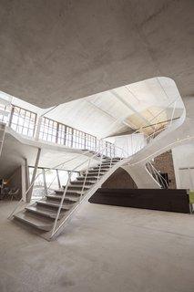 The loft is illuminated by Molto Luce Spots Turn On 110 lighting.