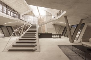 A sweeping concrete staircase leads the the upper levels of Loft Panzerhalle.