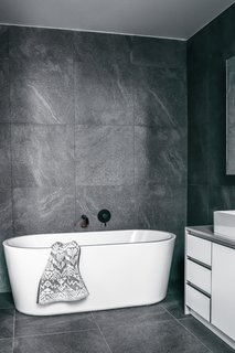 A Posh Solus freestanding bath anchors the bathroom.