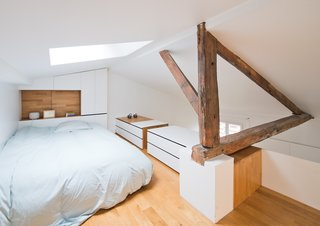 The natural light coming down from the second skylight bypasses the mezzanine to reach the bathroom at the lower level.