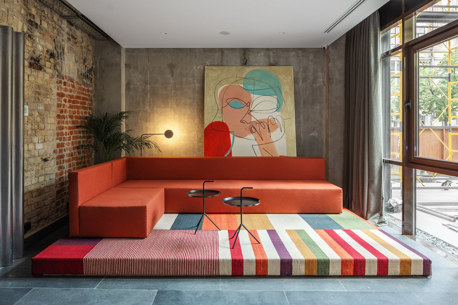 Living Room, End Tables, Sofa, and Floor Lighting  Best Photos from A Cool, Bauhaus-Style Hotel Revitalizes Two Historic Buildings in Kiev