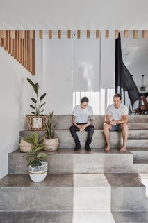 Salvador Farrajota and Brayden Larkin sit on the concrete stairs that lead up to the living areas.