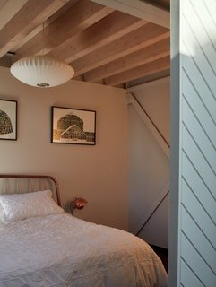A bedroom with a light blue sliding door.