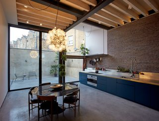 The open kitchen and dining area flows out to the courtyard.