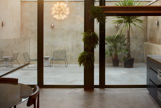 The outdoor terrace is rendered in concrete.
