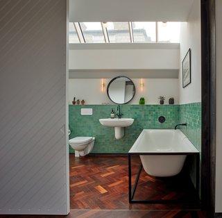 A freestanding bath lies underneath skylights in the master bathroom.