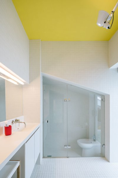 The bathroom can be accessed through an entryway at the back of the bathtub.