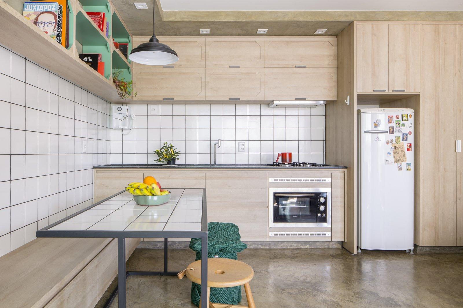 Gomez Apartment white tile kitchen