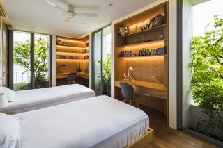 One of the bedrooms on the first floor has two study nooks.