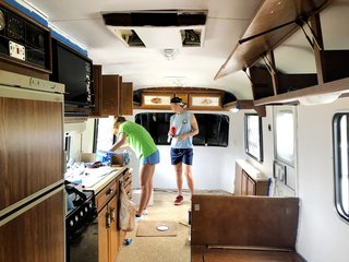 DeLisle and Goelz working on the interior of their 1986 Fleetwood Avion RV.