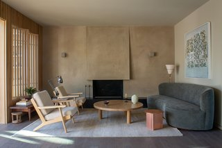 The wall paneling and living room screens are a waxed white oak.