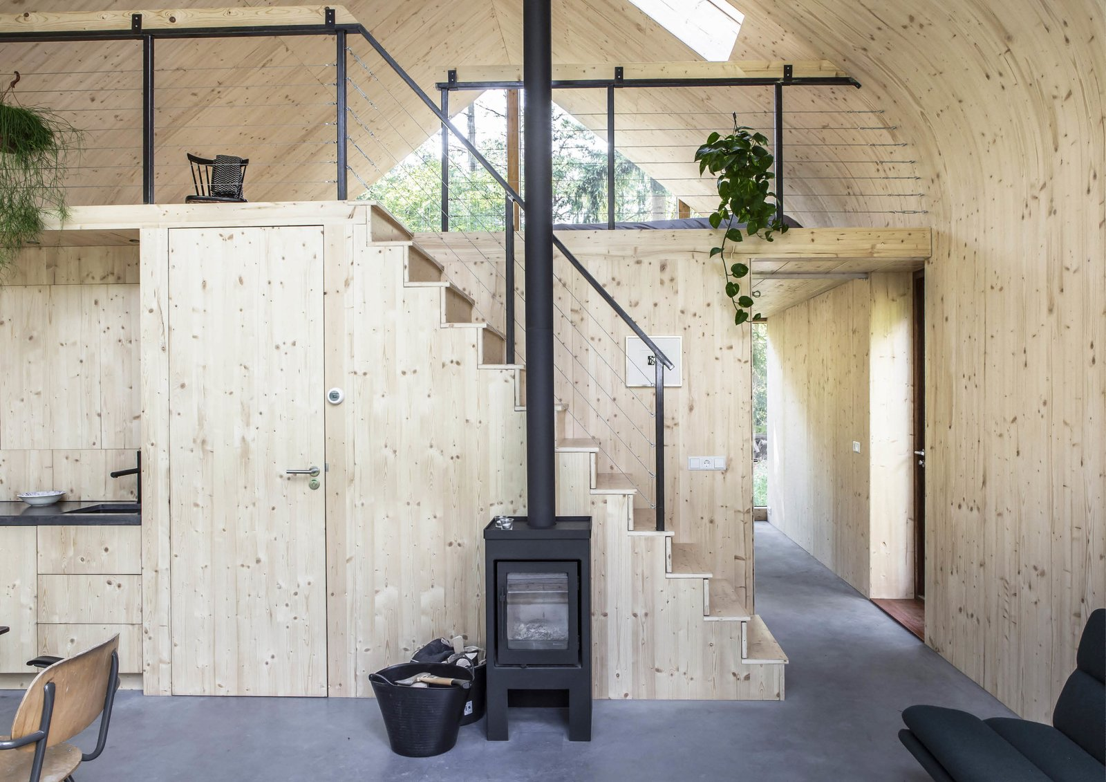Staircase, Metal Railing, and Wood Tread A hearth by de Vogelsangh warms the live/work prefab.�