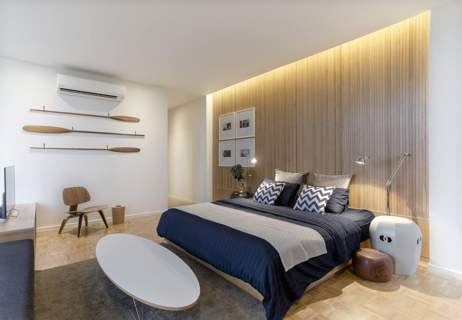 Bedroom, Bed, Chair, Recessed Lighting, Floor Lighting, and Light Hardwood Floor  Huamark 09