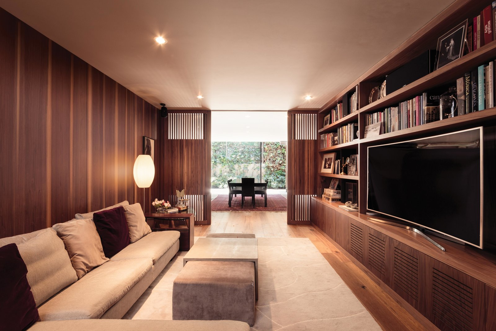 Living Room, Sofa, Coffee Tables, and Medium Hardwood Floor  Photos from Sierra Fria House