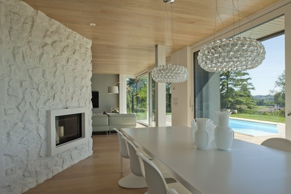 the dining room. Lamps Caboche Foscarini, Chairs Panton Vitra