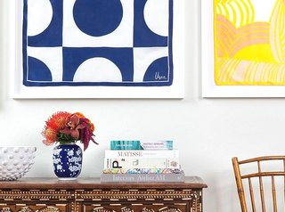 Framed art above a credenza Having your artwork framed makes it stand out so much more; Source: Simply Framed