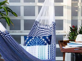 Cozy up with a good book in this comfy hammock; Source: Zola