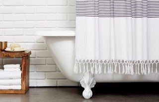 The Turkish Shower Curtain features a fetching, hand-knotted fringe hem; Source: Nicole LaMotte/Parachute