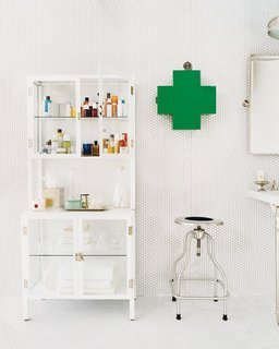 A clearly labeled first aid kit is an essential in every bathroom; Source: Domino