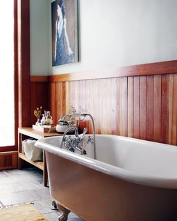 Display an assortment of bath accoutrement near the tub for guests to indulge; Source: Jessie Webster