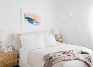 How to Design an Apartment You and Your Roommate Love - Photo 6 of 10 - White Linen Bedding: Parachute. Oatmeal Essential Quilt: Parachute. Mushroom Striped Cashmere Throw: Parachute. Morning River Print: Minted. Dean Sand Queen Upholstered Panel Bed: Living Spaces. Roar + Rabbit Brass Geo Nightstands: West Elm. Clear Disc Table Lamps: West Elm; Source: Amy Bartlam/Parachute