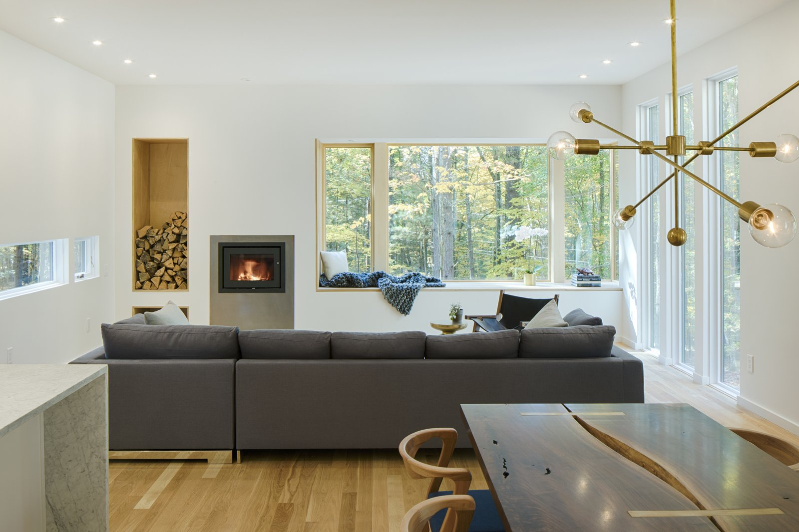 Tagged: Wood Burning Fireplace, Sofa, Recessed Lighting, Light Hardwood Floor, Chair, Table, and Living Room.  TinkerBox