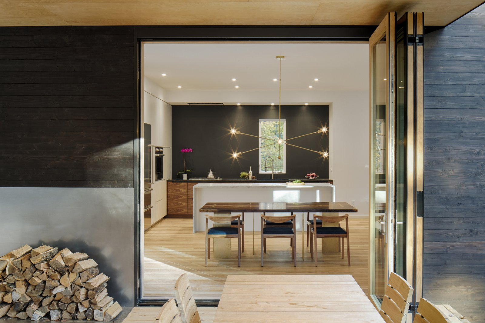 Dining Room, Table, Chair, Recessed Lighting, Accent Lighting, Light Hardwood Floor, and Storage  TinkerBox