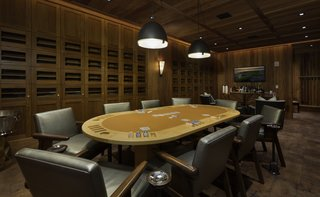 Kohanaiki Unveils One of the World's Largest Private Clubhouses on the Big Island of Hawaii - Photo 2 of 7 - Private cigar and card room hidden behind a secret door.