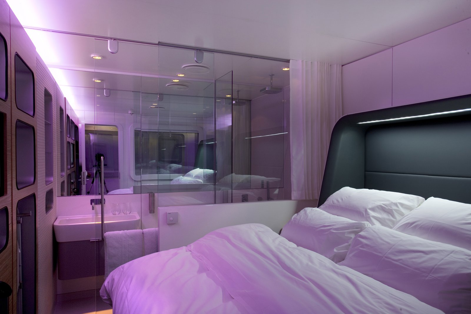 Bedroom, Bed, Storage, Shelves, Ceiling Lighting, Wall Lighting, and Wardrobe  Yotel