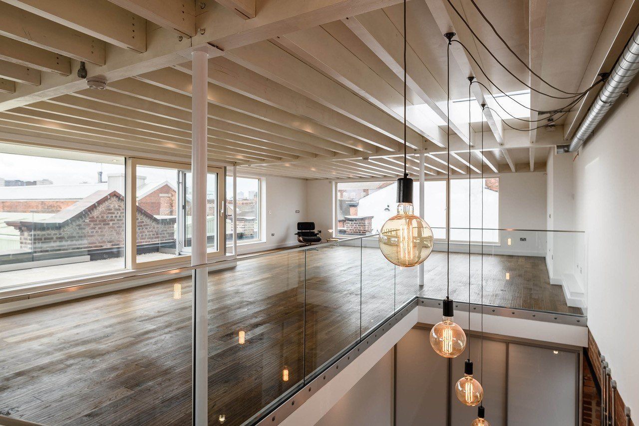Living Room, Recessed Lighting, Medium Hardwood Floor, and Pendant Lighting  Squirrel Works
