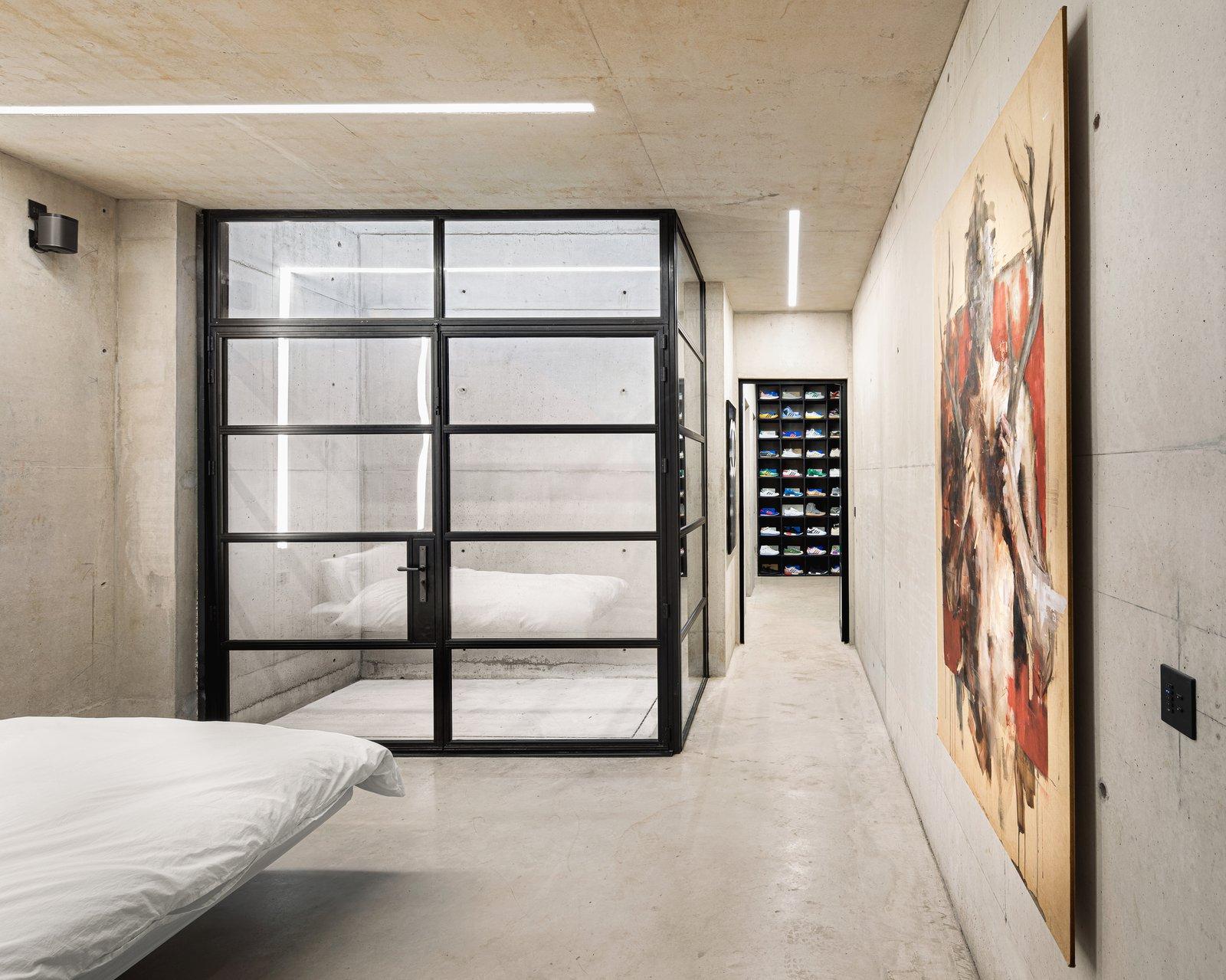 Bedroom, Bed, Marble Floor, Slate Floor, Storage, Ceiling Lighting, Limestone Floor, Shelves, and Track Lighting  Ghost House