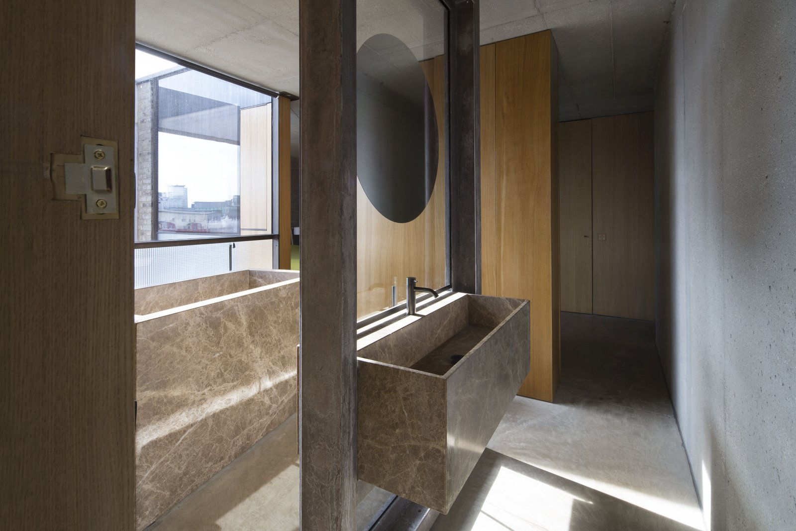 Bath Room, Concrete Floor, Freestanding Tub, Concrete Wall, and Vessel Sink  Photos from Clerkenwell Close