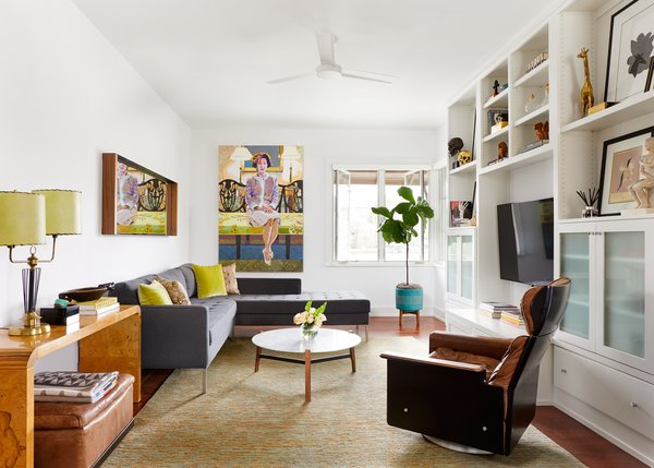 Upstairs den featuring a vintage Deiter Rams 620 chair and ottoman, Milo Baughman burl wood console table, original oil on canvas art by Austin's own, Elizabeth Chapin, Blu Dot's Paramount sectional, Free Range coffee table and mirror mirror. Planter from West Elm.